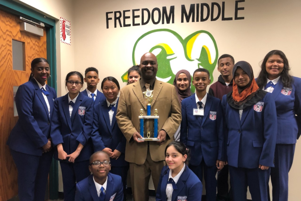 Image of Freebots Team from Freedom Middle School with Their Principal